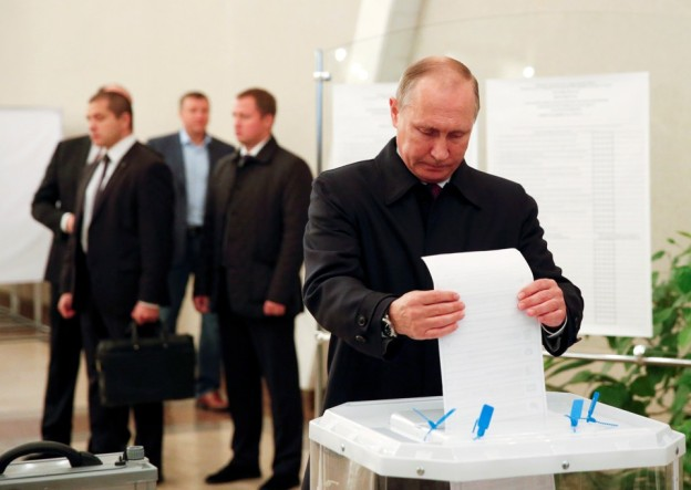 Russian President Putin visits polling station during parliamentary election in Moscow